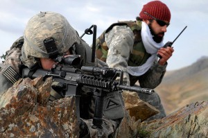 U.S. Army 1st Lt. Jared Tomberlin, left, and an interpreter pull security on top of a mountain ridge during a reconnaissance mission near Forward Operating Base Lane in the Zabul province of Afghanistan Feb. 28, 2009. Image via Wikimedia Commons.